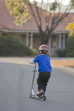 Boy and Scooter Royalty Free Stock Photos