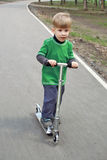 Boy on scooter Royalty Free Stock Photo