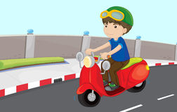 Boy on a scooter. Boy driving scooter on the road Stock Photography