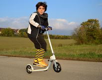 Boy on scooter Stock Image