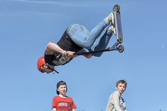 Boy on scooter flips in the air. The youth festival of extreme sports, park 300th anniversary, St. Petersburg, Russia Stock Images