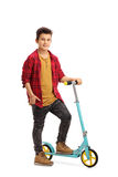 Boy with a scooter Stock Images