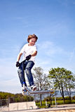 Boy with scooter is going airborne Stock Photo