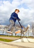 Boy with scooter Stock Image