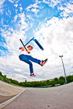 Boy with scooter is going airborne Royalty Free Stock Photo