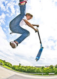 Boy with scooter is going airborne Stock Photography