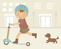 Boy on scooter Stock Images