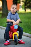 Boy on scooter Royalty Free Stock Images