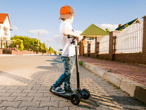 Boy on scooter Stock Photos