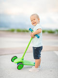 Boy with scooter Royalty Free Stock Photography