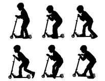Boy on scooter_1. The boy rolls a scooter. Leisure and entertainment Royalty Free Stock Images