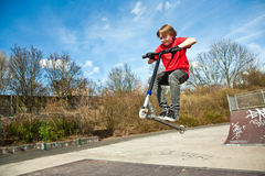 Boy with scooter at the skate parc Stock Photo