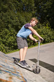 Boy is scooting royalty free stock images
