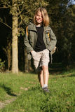 Boy scout. Young boyscout walking in forest Stock Photography