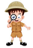 Boy scout. With magnifying glass Royalty Free Stock Photos