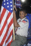 Boy Scout with an American flag at the Clinton/Gore 1992 Buscapade campaign tour in Tyler, Texas Royalty Free Stock Images