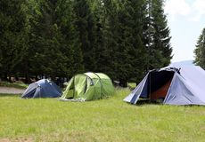 Boy scout camp with tents to sleep during the summer camp. Boy scout camp with three tents to sleep during the summer camp stock image