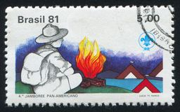 Boy Scout and Campfire. BRAZIL - CIRCA 1981: stamp printed by Brazil, shows  Boy Scout and Campfire, circa 1981 Stock Image
