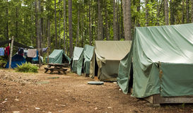 Boy Scout Campground. A typical campsite at a Boy Scout Camp includes tents, a table, dirt, and dirty clothes drying on a rope royalty free stock photography