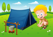 Boy scout camping. With camping tent Stock Photography