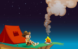 A boy scout camping near the cliff Royalty Free Stock Photo