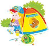 Boy scout with a camping tent Royalty Free Stock Photography