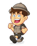 Boy Scout or Explorer Boy Walking. Vector clipart picture of a Boy Scout or Explorer Boy cartoon character Walking Royalty Free Stock Photo