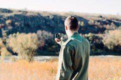 Boy Scout Holding a Compass to Find Direction Stock Photography