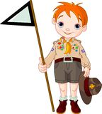 Boy scout  holding a flag. Young  happy boy scout  holding a flag Royalty Free Stock Images