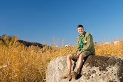 Boy Scout on Large Rock at the Camp Area Stock Image
