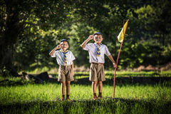 Boy scout making an oath, asia stock images