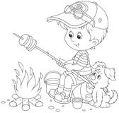Boy-scout roasting bread on campfire. Black and white vector illustration of a little boy traveler and his small pup cooking bread on fire Royalty Free Stock Images