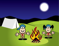 Boy scouts at camp. Boy and girl scouts by a campfire at night Royalty Free Stock Photography