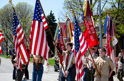 Boy scouts with flags Stock Photo