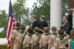 Boy Scouts and judge saying the Pledge of Allegian. Ce with 76 new American citizens at Independence Day Naturalization Ceremony on July 4, 2005 at Thomas Stock Images