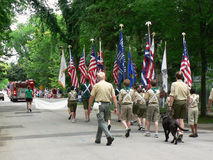 Boy Scouts march in Fourth of July parade. Winnetka, Illinois, United States - July 4, 2007: A Boy Scout troop marches in a Fourth of July parade Royalty Free Stock Image