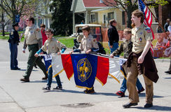 Boy scouts marching in a parade Royalty Free Stock Photos
