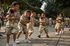 Boy Scouts play tug of war. HO CHI MINH CITY, VIETNAM - DEC 29, 2013: Vietnamese boy scouts struggle while playing tug of war stock photo