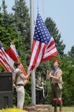 Boy scouts raising the flag. ANN ARBOR, MI - MAY 27: Boy scouts raise the flag at the Memorial Day observance on May 27, 2012 at Arborcrest Memorial Park in Ann stock image