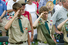 Boy Scouts saluting 76 new American citizens. At Independence Day Naturalization Ceremony on July 4, 2005 at Thomas Jefferson's home, Monticello Royalty Free Stock Photography