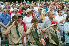 Boy Scouts saluting 76 new American citizens. At Independence Day Naturalization Ceremony on July 4, 2005 at Thomas Jefferson's home, Monticello Royalty Free Stock Images