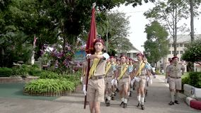 Boy Scouts of Thailand carry flags in parade. Slow Motion stock footage