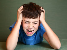 Boy scratch his head isolated on blue. Preteen handsome boy scratch his head isolated on blue stock photography