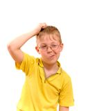 Boy scratches his head in puzzlement or confusion. As if pondering a deep question. Over white background Stock Image