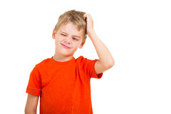 Boy scratching head. Young boy scratching his head isolated on white stock photo