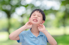 Boy scratching his allergy face outdoor Royalty Free Stock Photo
