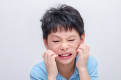 Boy scratching his allergy face Stock Images