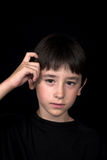 Boy scratching his head Stock Images