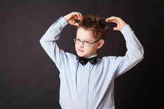 Boy  scratching his head thinking Stock Images