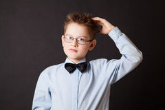 Boy  scratching his head thinking Royalty Free Stock Photos